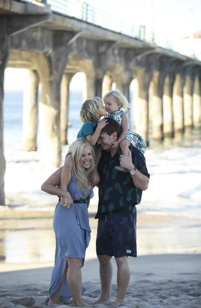 full time travel family at the beach