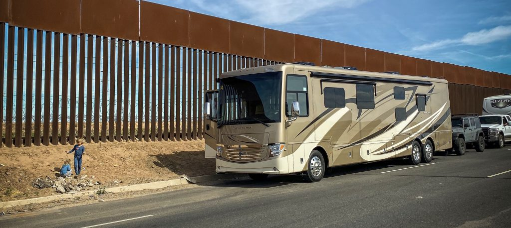 RV parked next to the border wall in Baja, Mexico. Is Baja Safe?